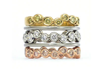 Three Diamond Rings in yellow, white and pink gold Fine Jewelry Design by Martinus